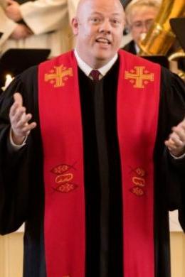 Rev. J.C. Austin leading a service